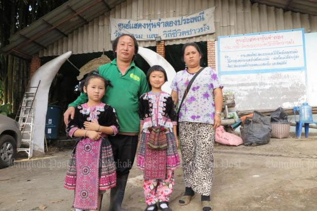 Dokmai and Gaolhee with their parents. The Hmong girls have finally cleared their names after the international media wrongly labelled them