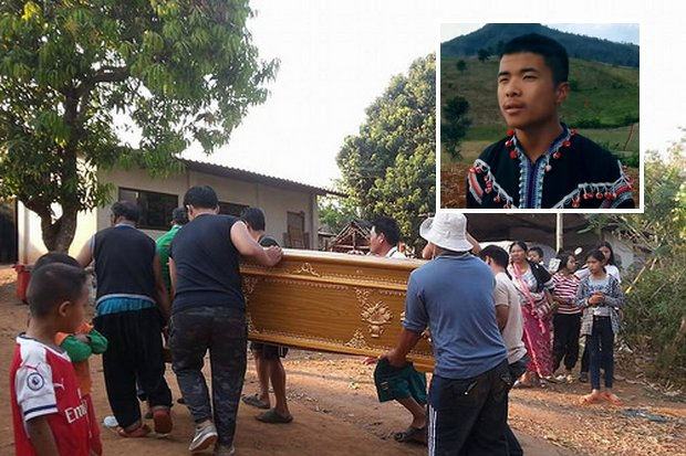 Relatives and villagers return the remains of artist-activist Chaiyapoom Pasae after he was killed by a soldier. (Photo via Prachaitai)