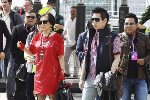 Vorayudh Yoovidhaya, mum Daranee and brother Varit (right) live it up as special guests at the 2013 British Grand Prix at Silverstone just months after Vorayudh's Ferrari crushed, dragged and killed a policeman. (Photo via AP)