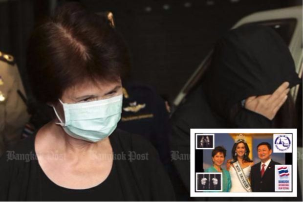 Former Tourism Authority of Thailand (TAT) governor Juthamas Siriwan, wearing a face mask, keeps her eyes lowered while her daughter Jittisopha shields her face as they are taken to a cell  at the Central Women's Correctional Institution on Wednesday after being given lengthy jail terms for accepting bribes. (File photo by Patipat Janthong)