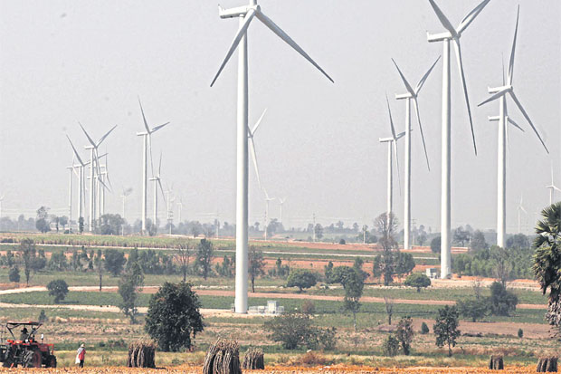 A wind turbine  farm rises above  cassava  plantations in  Dan Khun Thot  district, Nakhon  Ratchasima. The  Agricultural Land  Reform Office  has ruled that  wind farm  projects can be  developed on Sor  Por Kor  land. PANUMAS  SANGUANWONG