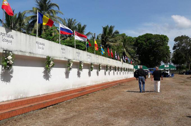 Wreaths decorate the Memorial Wall at Mai Khao Cemetery in Phuket after a religious ceremony to mark the 12 anniversary of the 2004 tsunami on Dec 26, 2016. (Bangkok Post file photo)