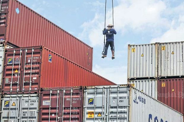 Containers sit in stacks at Bangkok port as shippers warn of lower-than-expected exports because of the stronger baht. (Bangkok Post file photo)