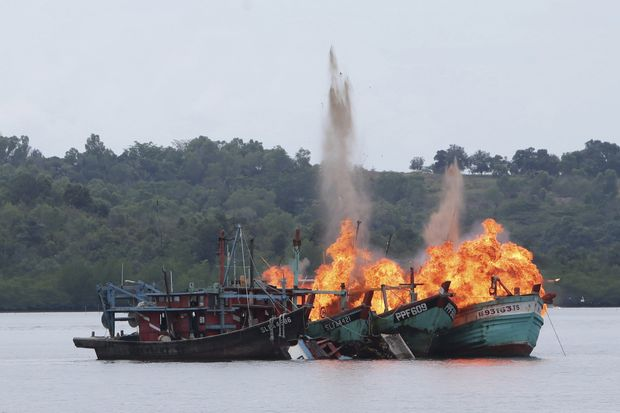 Malaysian and Vietnamese fishing boats are destroyed for illegal fishing by the Ministry of Maritime Affairs and Fisheries, police and navy, in Batam, Riau Islands, Indonesia, on April 5, 2016. (Reuters/M N Kanwa /Antara Foto via Reuters)