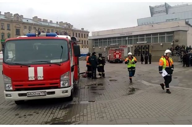 In this image taken from video footage, emergency services work outside Sennaya Square metro station in St Petersburg, Russia, on Monday. (AP Photo)