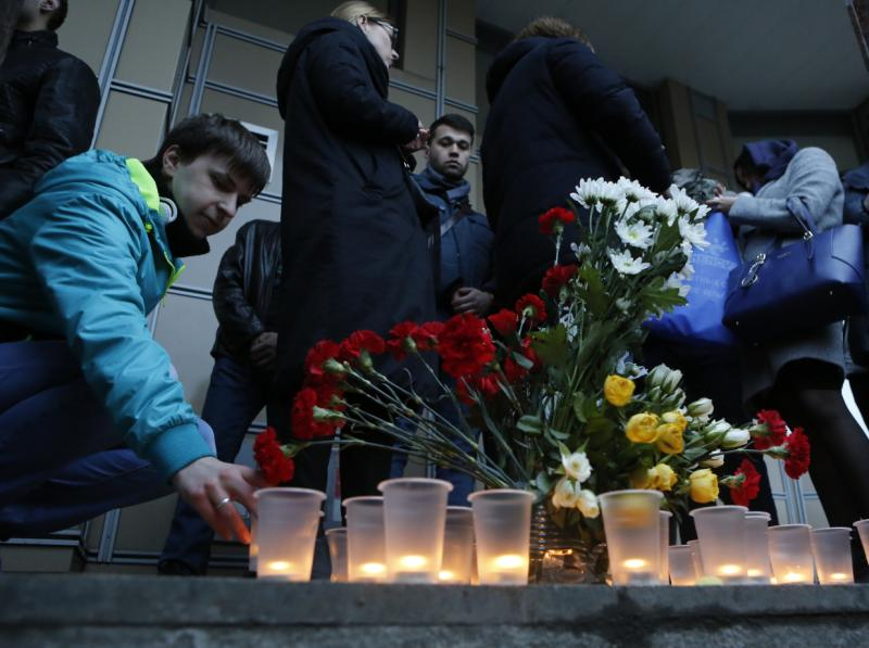 People light candles at an entrance of Sennaya Ploshchad station after an explosion in St Petersburg subway, Russia, on Monday. (AP photo)