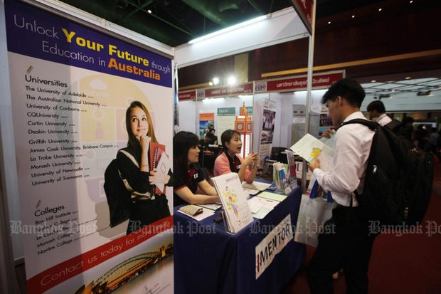 A student checks the details of a school in Australia at a Bangkok Post Career-Education Expo. (File photo by Pawat Laopaisarntaksin)