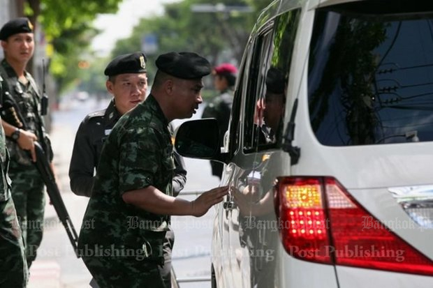 The Royal Thai Armed Forces announced Tuesday it has drafted 20,000 vocational students and teachers to man Songkran checkpoints with soldiers and police, although the authority and duties of the untrained students are unclear. (Bangkok Post file photo)