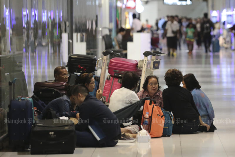 Passengers were stranded at Suvarnabhumi airport on Tuesday night after discovering there was no trip to Japan after all. (Photo by Patipat Janthong)