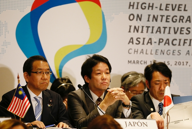 Japan is looking to raise its profile along the Pacific Rim, and was a key participant at the Alianza del Pacifico (Pacific Alliance) summit in Vina del Mar, Chile last month. From left: Cabinet Office Minister Takao Ochi, Foreign Minister Kentaro Sonoura and Toshinao Nakagawa, Vice-Minister of Economy, Trade and Industry. (Reuters Photo)