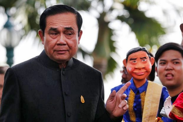 Prime Minister Prayut Chan-o-cha enters Tuesday's cabinet meeting with a warning and his opinion: 'Old subjects are just history.' (Reuters photo)