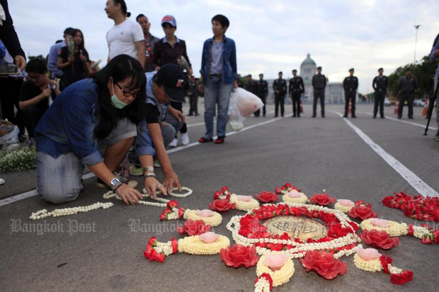 Flashback: June 24, 2016, at the Royal Plaza. Activists lay flowers around the metal shield of the Khana Ratsadon (People's Party) - instrumental in transforming the country from an absolute to a constitutional monarchy on June 24, 1932. (File photo by Apichart Jinakul)