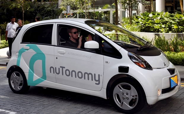 A tester with the US-Singaporean startup nuTonomy shows his hands as his driverless car navigates a road in the city-state. nuTonomy is aiming to introduce an on-demand robo-taxi service commercially in Singapore next year. (Reuters Photo)