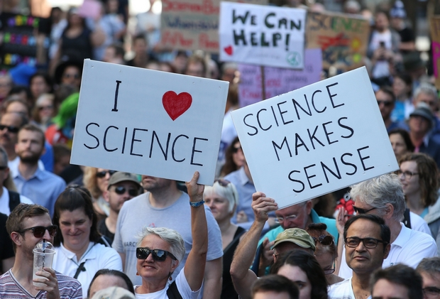 People hold placards during the March for Science in Sydney, one of the first places to stage the worldwide event on Saturday. (EPA Photo)