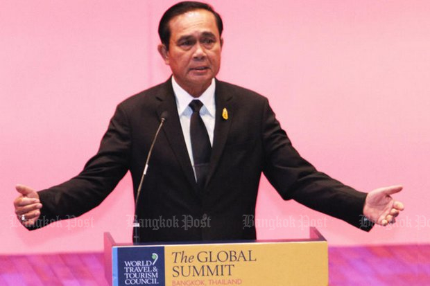 Prime Minister Prayut Chan-o-cha said Thursday he personally disagrees with proposals to force 'reform' of the media. He spoke after a speech to the opening of the UN's summit on tourism. (Photo by Thanarak Khunton)