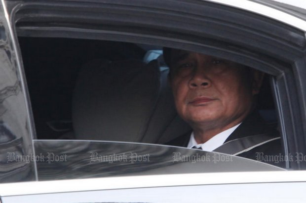 Prime Minister Gen Prayut Chan-o-cha surveys the Thai media and all else that he controls from his limousine. (Photo by Thiti Wannamontha)