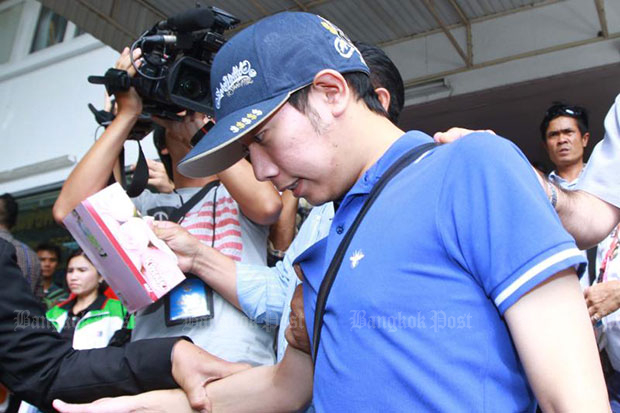 Vorayuth Yoovidhya is taken to the Police General Hospital to undergo a blood test in September 2012 following a hit-and-run collision that killed a policeman. (Bangkok Post file photo)