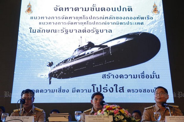 Adm Luechai Ruddit (centre), chief of staff of the Royal Thai Navy, clarified the navy's role in the purchase of the submarine from China, which comes with a two-year warrantee on parts and labour. (Photo by Wichan Charoenkiatpakul)