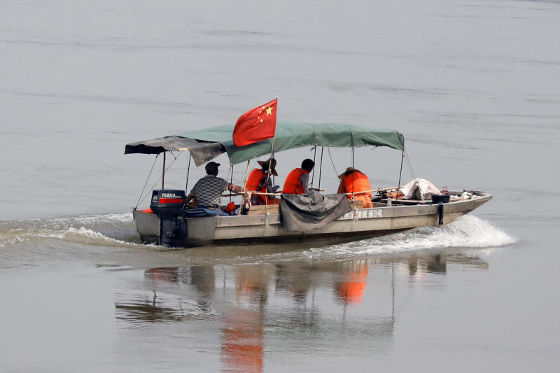 A small boat flies a Chinese flag on the Mekong River. (Reuters photo)