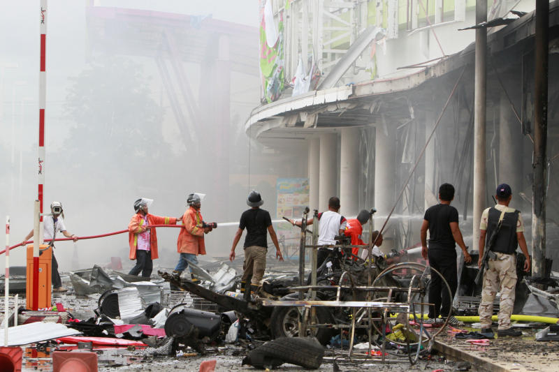 Firefighters douse a fire after two bombs exploded at Big C Supercenter in Muang district of Pattani on Tuesday. (Reuters photo)