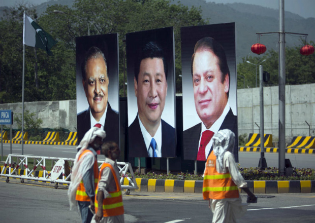 A billboard showing pictures of Chinese President Xi Jinping, centre, with Pakistan's President Mamnoon Hussain, left, and Prime Minister Nawaz Sharif on display during a visit by the Chinese president to launch an ambitious $45 billion economic corridor linking Pakistan's port city of Gwadar with western China, in Islamabad, Pakistan. (AP Photo/B.K. Bangash, File)