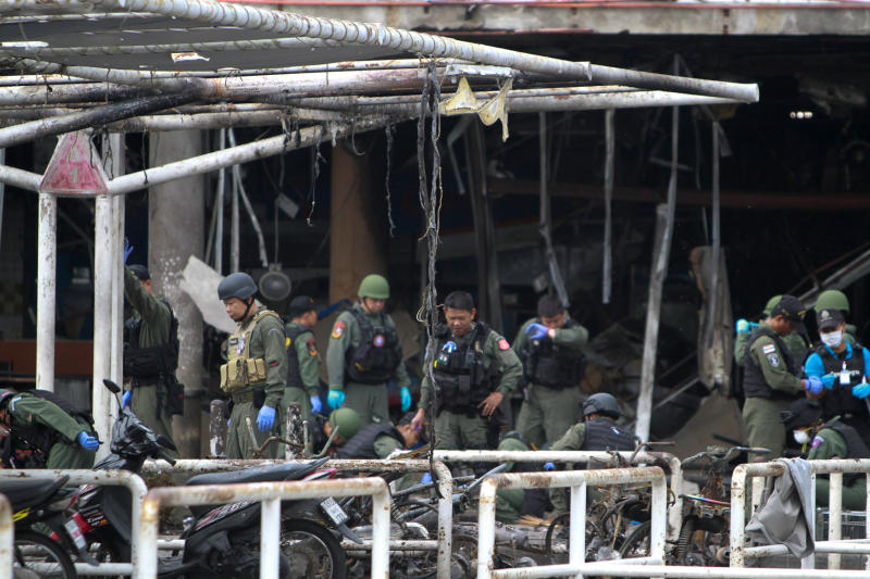 Military personnel inspect the site of a bomb attack at Big C Supercenter in Muang district, Pattani, on Wednesday. (Reuters photo)