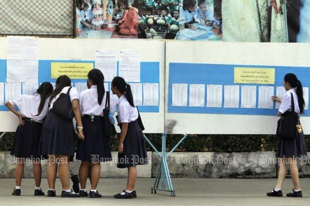 Freshmen check their entrance exam marks. Within a decade, if present trends continues, three-quarters of Thai universities will be gone. (Bangkok Post file photo by Thanarak Khunton)