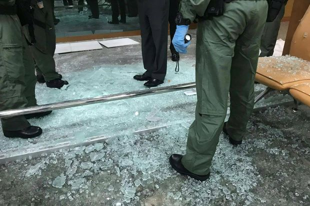 Police check the dispensary's waiting room where a bomb went off at Phramongkutklao Hospital on Monday. Twenty-one people were injured. (Royal Thai Police photos)