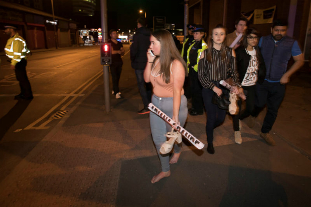 Concert-goers react after fleeing the Manchester Arena in northern England where US singer Ariana Grande had been performing in Manchester, Britain, May 22, 2017. (Reuters photo)