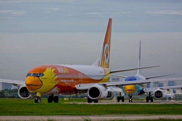 Nok Air jets at Don Mueang airport. The budget carrier may gain more control over its fate after THAI's refusal to join a rights offering. (File photo by Krit Promsaka Na Sakolnakorn)