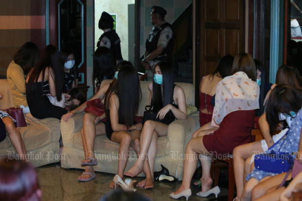 """In this file photo, 115 Thai and foreign women - some under 18 - working at Nataree Massage on Ratchadaphisek Road are detained during a raid by Interior Ministry officials in June, 2016. Human trafficking in and out of Thailand remains rampant; hundreds of women were brought from Thailand to the US and forced to be """"modern day sex slaves"""", according to an indictment unsealed Thursday. (Bangkok Post photo)"""