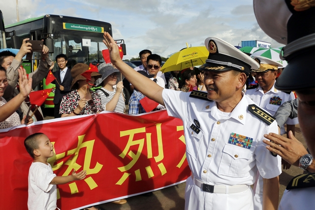 Capt Wang Hong Li, commanding officer of the 23rd Chinese naval escort task force, greets local Chinese residents during a call by two Chinese frigates at the Thilawa International Port near Yangon in September last year. (AP Photo)