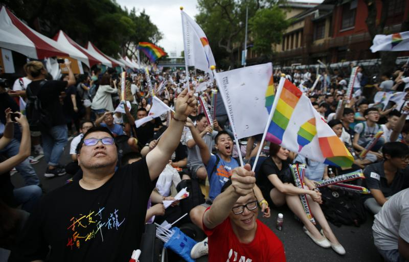 Supporters of the LGBT (Lesbian, Gay, Bisexual and Transgender) rights react as they gather in support of legalising same-sex marriage after hearing the Constitutional Court ruling outside the Taiwan parliament building in Taipei on Wednesday. (EPA photo)