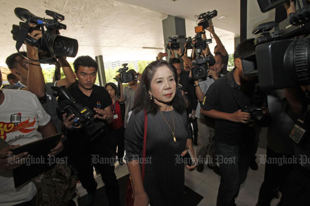 Monta Yokrattanakan aka Ying Kai appears at the Criminal Suppression Division in Bangkok in July last year to acknowledge lese majeste and human trafficking charges. (Bangkok Post file photo)