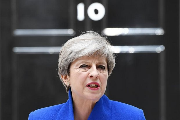 Prime Minister Theresa May speaks with the media outside her official home at 10 Downing Street. (EPA photo)