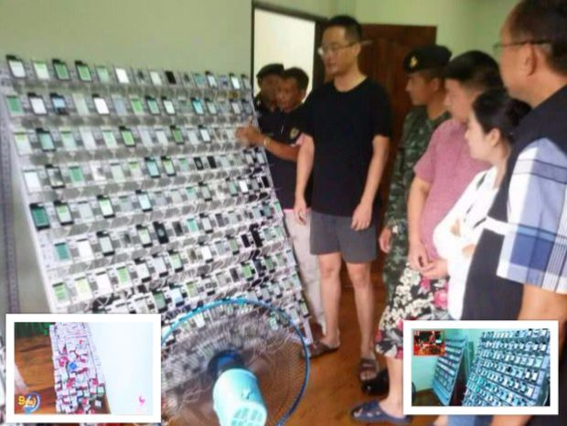 Racked phones used as bots at the raided house in Aranyaprathet. (Screen capture from Channel 9 News)