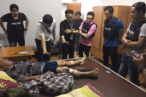 Japanese businessman Tsunemi Watanabe, 56, rests after his rescue by police in Bangkok last week. (Royal Thai Police photo)