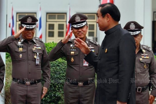 Prime Minister Prayut Chan-o-cha, seen here on an official inspection of the Royal Thai Police headquarters, says he has plenty of complaints about buying promotions in the RTP. (Bangkok Post file photo by Somchai Poomlard)