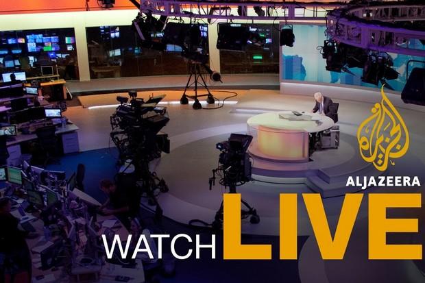 A new anchor prepares for a broadcast at the main Al-Jazeera studios in Qatar. (Screen capture YouTube/AlJazeeraEnglish