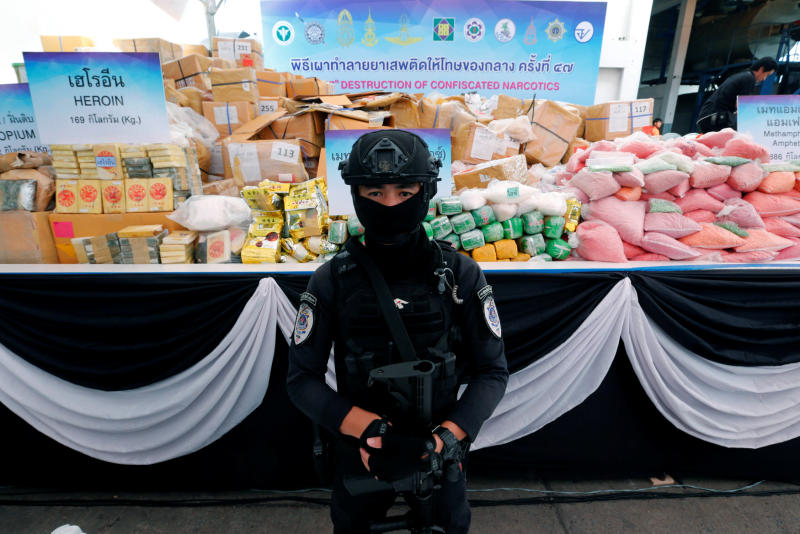An officer from the Narcotics Control Board stands guard in front of bags of confiscated drugs before they were incinerated at the Bang Pa-in Industrial Estate in Bang Pa-in district of Ayutthaya on Monday. (Reuters photo)