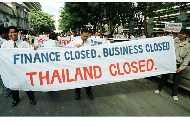 Silom Road, 1997. The baht has collapsed and a very unpopular IMF is imposing massive restrictions on the country. (Reuters photo)