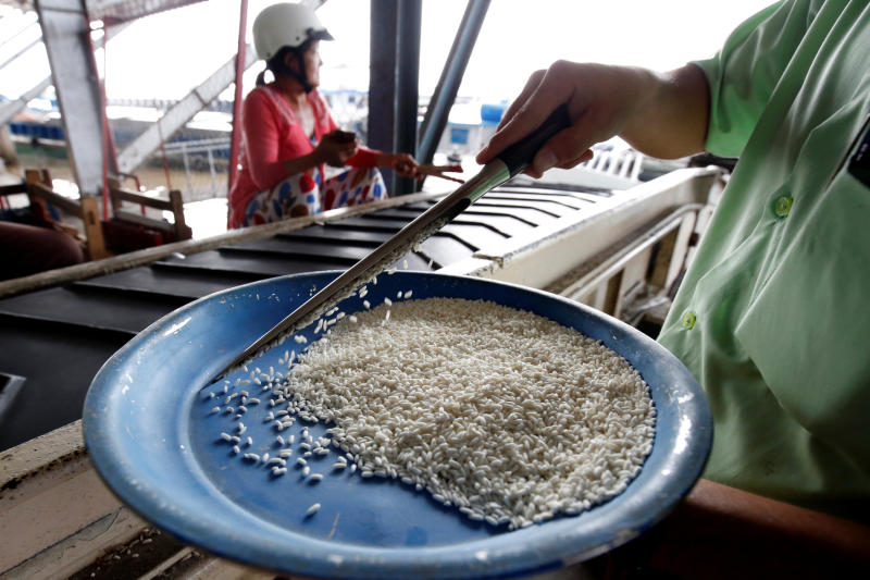 A man gets a sample for quality checking at a rice-processing factory in Vietnam's southern Mekong delta on Thursday. (Reuters photo)