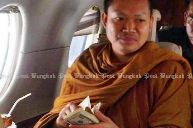 One of the early revelations about the then-monk Luang Pu Nem Kham was his use of private helicopters and jet planes - while flaunting stacks of US currency. (Bangkok Post file photo)