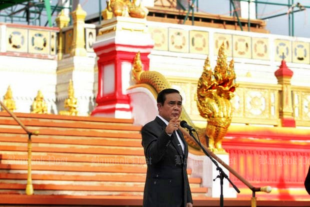 Prime Minister Prayut Chan-o-cha, seen here during last week's inspection of the royal crematorium at Sanam Luang, took a hard line against foreign tour guides, because it is an occupation reserved for Thais. (Post Today photo)