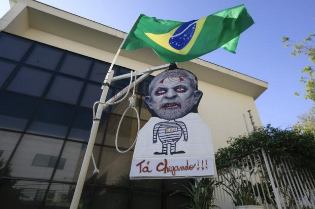 A caricature of former Brazilian president Luiz Inacio Lula da Silva hangs in front of the Lula Institute in Sao Paulo last week. Recent found guilty of corruption charges, former national hero Lula faces a prison sentence of up to 10 years. (EPA photo)