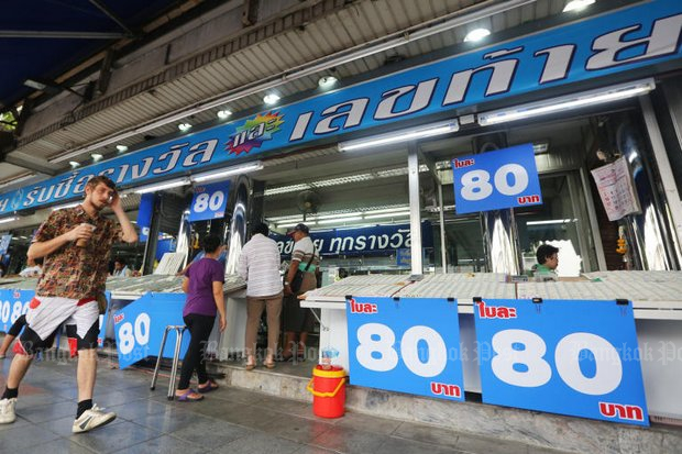 Authorities say no one should be able to combine tickets and win 180 million baht - but one man did.