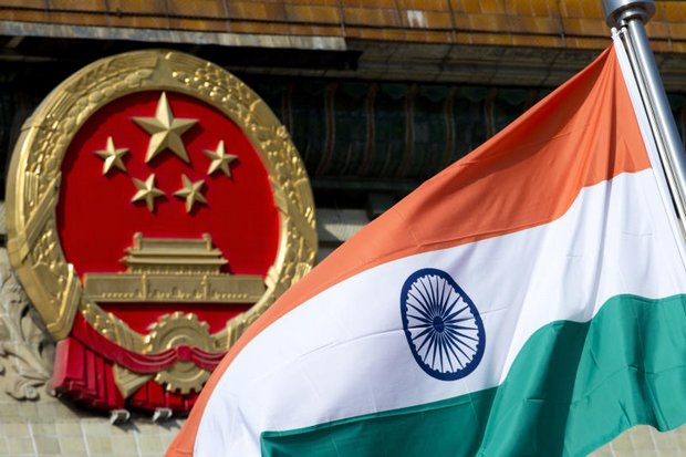 An Indian national flag is flown next to the Chinese national emblem in Beijing. The two countries were involved in a flare-up last month over the Bhutan-claimed Doklam plateau.(AP photo)