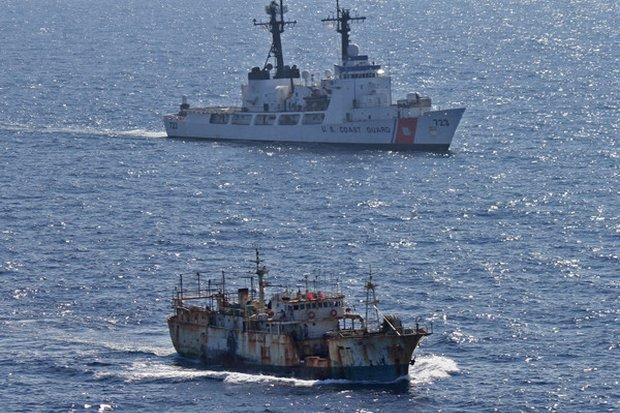 The US Coast Guard cutter Rush escorts a suspected high seas drift net fishing vessel. (Photo courtesy US Coast Guard)