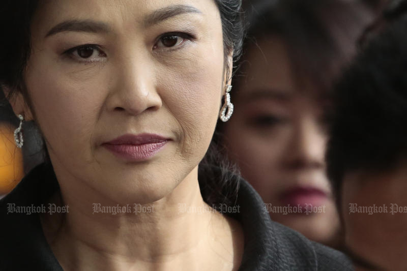 Former prime minister Yingluck Shinawatra left the Supreme Court's Criminal Division for Holders of Political Positions after the last defence hearing on the rice-pledging case on Friday. (Photo by Patipat Janthong)