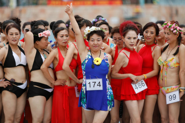 A participant in the Third Grandbikini event reacts after being awarded by judges in an aqua park in Tianjin, China on Saturday. (Reuters photo)